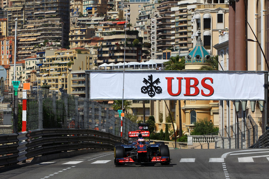 Jenson Button powers up the hill towards Casino Square