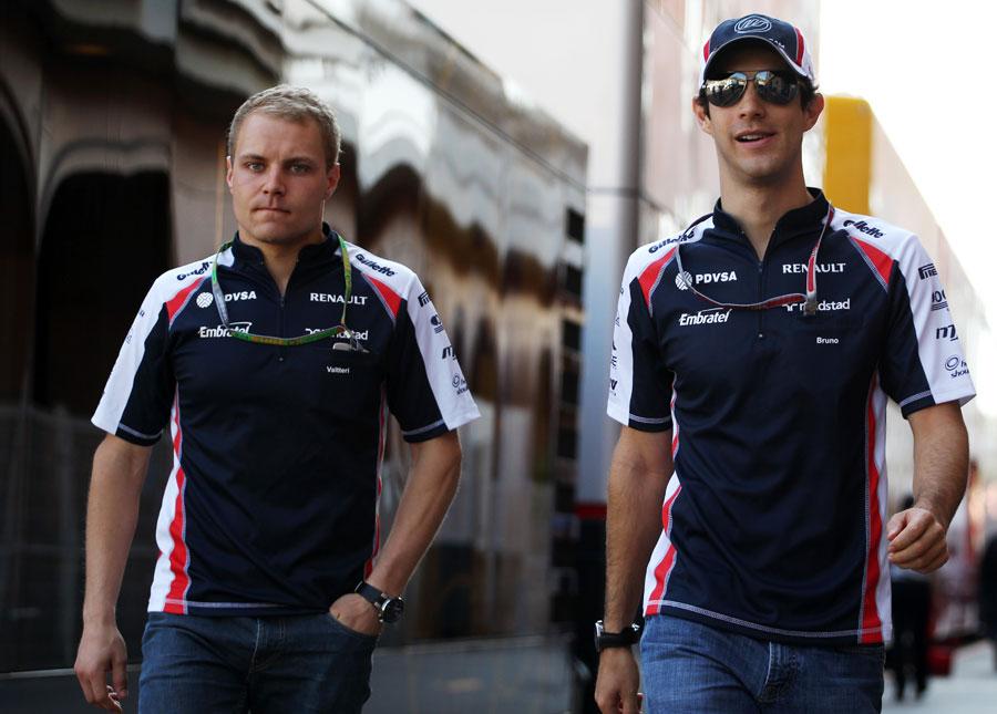 Valtteri Bottas and Bruno Senna arrive in the paddock on Saturday