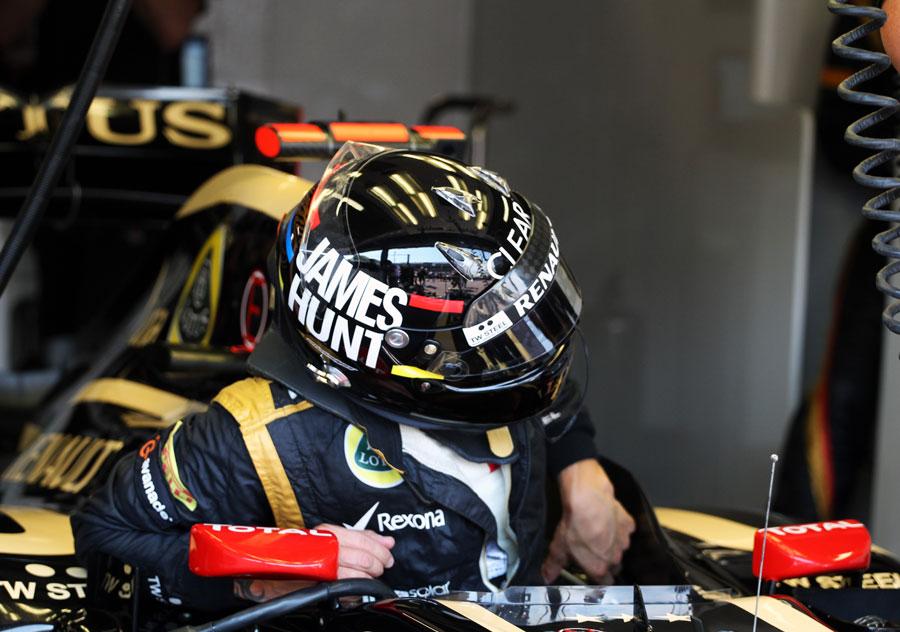 Kimi Raikkonen climbs out of the cockpit of his Lotus