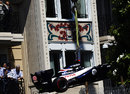 Pastor Maldonado's Williams is craned away after a crash at Casino Square