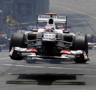 Kamui Kobayashi is launched into the air at the start of a tense Monaco Grand Prix won by Mark Webber
