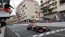 Mark Webber takes the chequered flag with Nico Rosberg and Fernando Alonso close behind