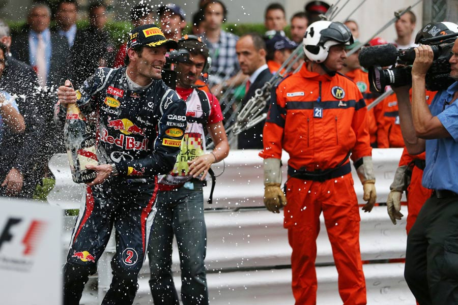 Mark Webber sprays champagne after winning in Monaco
