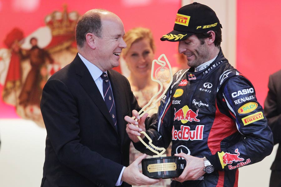 HRH Prince Albert of Monaco presents the winners' trophy to Mark Webber