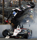 Will Power drives under an airborne Mike Conway after they made contact at the Indy 500