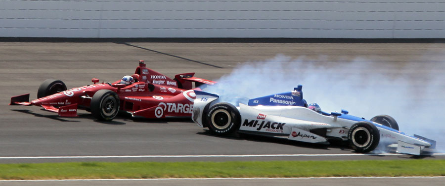 Dario Franchitti moves clear as Takuma Sato crashes on the final lap