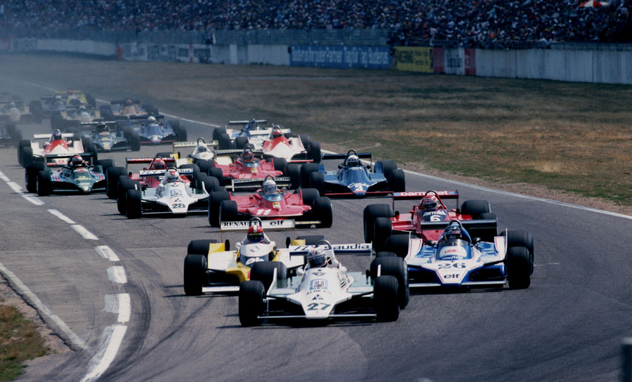 Alan Jones leads at the start of the race