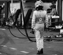 Jenson Button trudges back to the pits after his retirement