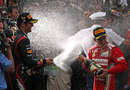 Mark Webber sprays Fernando Alonso with champagne after winning in Monaco