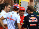 Fernando Alonso chats with Paul di Resta, Jenson Button and Sebastian Vettel