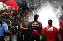 Mark Webber and Fernando Alonso spray the champagne