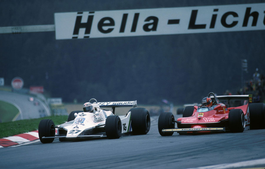 Alan Jones dives down the inside of Gilles Villeneuve to take the lead
