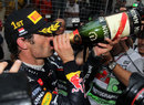 Mark Webber takes a swig of champagne after winning in Monaco