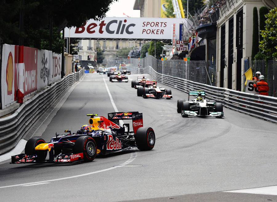 Mark Webber leads the pack under the safety car