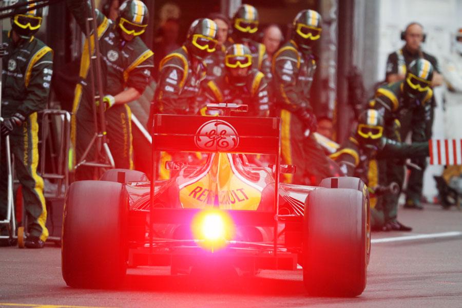 Heikki Kovalainen makes a pit stop