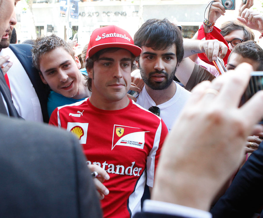 Fernando Alonso attends the opening of the Ferrari Store in Madrid