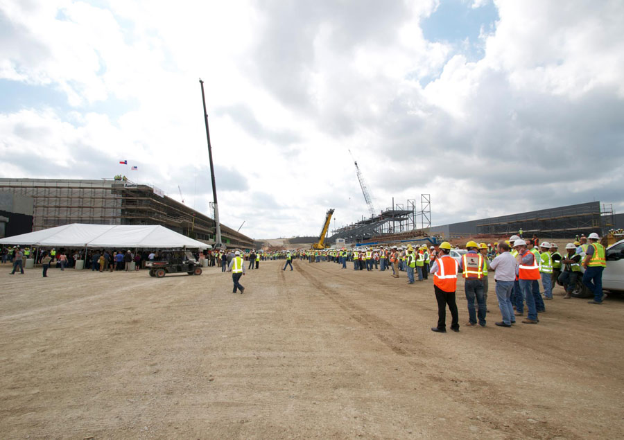 Workers congregate for a topping off ceremony at the Circuit of the Americas