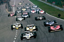 Alan Jones leads Gilles Villeneuve and the Renaults in to turn one as Carlos Reutemann loses a wheel