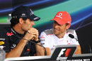 Jenson Button jokes with Mark Webber in the driver press conference