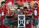 Ferrari mechanics at work on Thursday