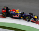 Sebastian Vettel rides the kerbs in his Red Bull