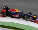 Sebastian Vettel rides the kerbs in his Red Bull