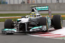 Nico Rosberg hops over the kerbs in his Mercedes