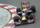 Sebastian Vettel aims for the apex in his Red Bull