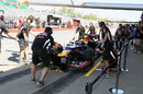 Mark Webber completes a practice pit stop