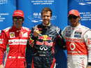 Sebastian Vettel celebrates taking pole position ahead of Lewis Hamilton and Fernando Alonso