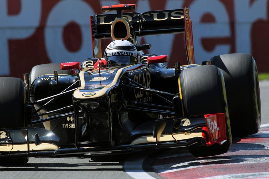 Kimi Raikkonen rides the kerbs in his Lotus