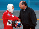 Michael Schumacher shakes hands with Ron Dennis