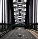 Mark Webber drives his Williams F1 car over the Sydney Harbour Bridge