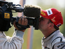 Rubens Barrichello kisses a TV camera