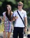 Jenson Button arrives in the paddock with girlfriend Jessica Michibata