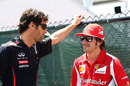 Mark Webber and Fernando Alonso chat ahead of the race