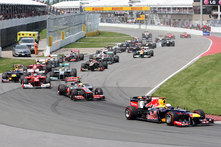 Sebastian Vettel leads the field in to turn one