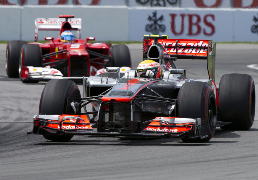 Lewis Hamilton leads Fernando Alonso early in the race