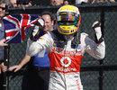 Lewis Hamilton celebrates his victory in parc ferme