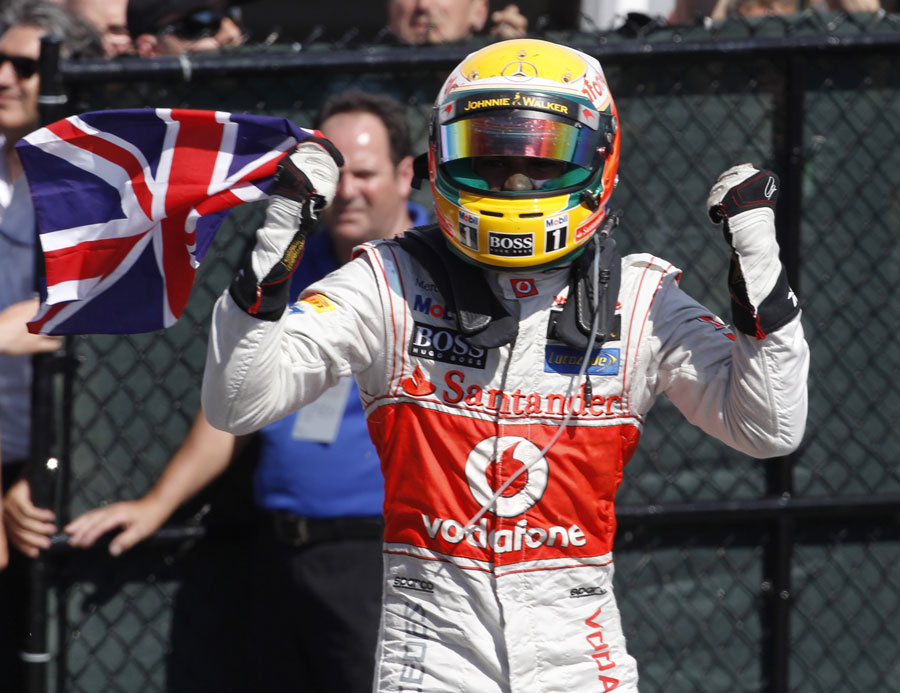 Lewis Hamilton celebrates his victory in parc ferme