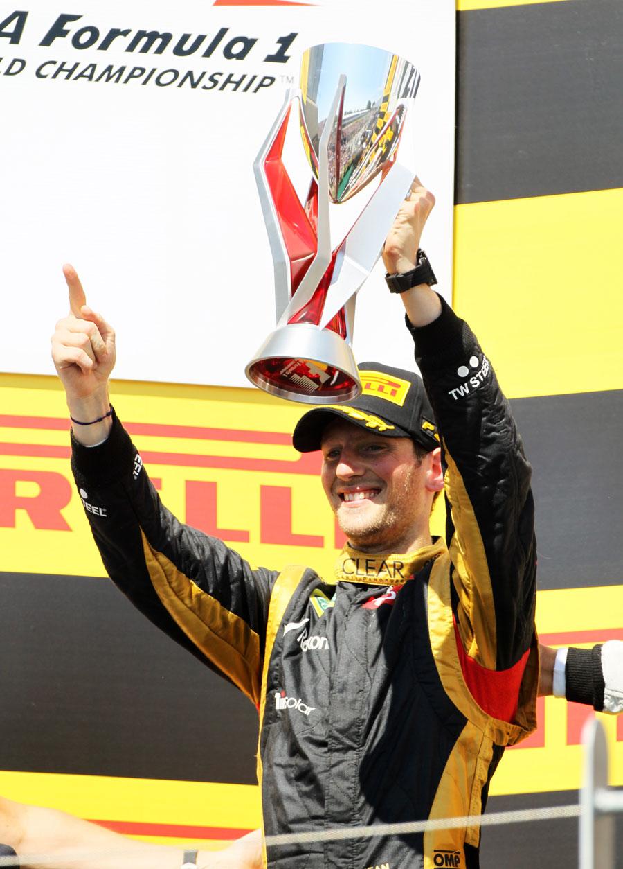 Romain Grosjean celebrates his second place on the podium