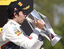 Sergio Perez celebrates on the podium