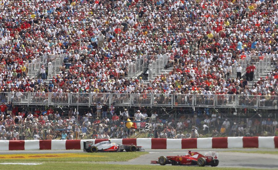 Lewis Hamilton and Fernando Alonso tackle the opening sector in front of a large crowd