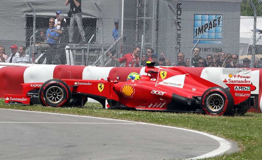 Felipe Massa spins off the track at turn two