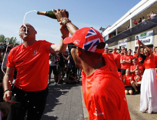 Lewis Hamilton celebrates his victory in Canada with McLaren chairman Ron Dennis