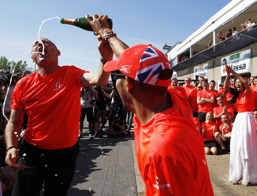 Lewis Hamilton celebrates his victory with McLaren chairman Ron Dennis