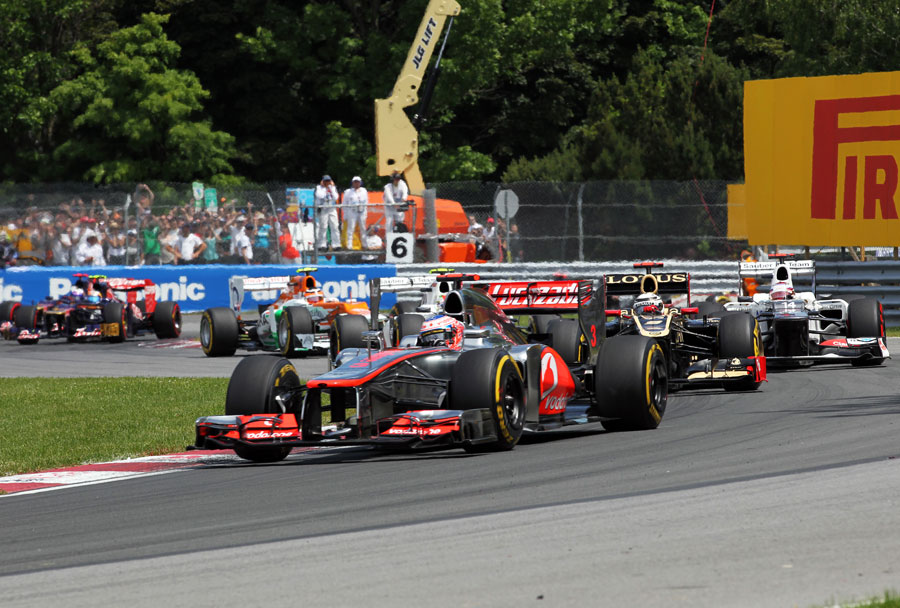 Jenson Button leads a train of cars early in the race