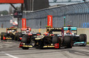 Romain Grosjean leads a pack of cars into the final chicane