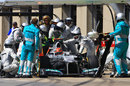 Mercedes mechanics work on Michael Schumacher's broken DRS