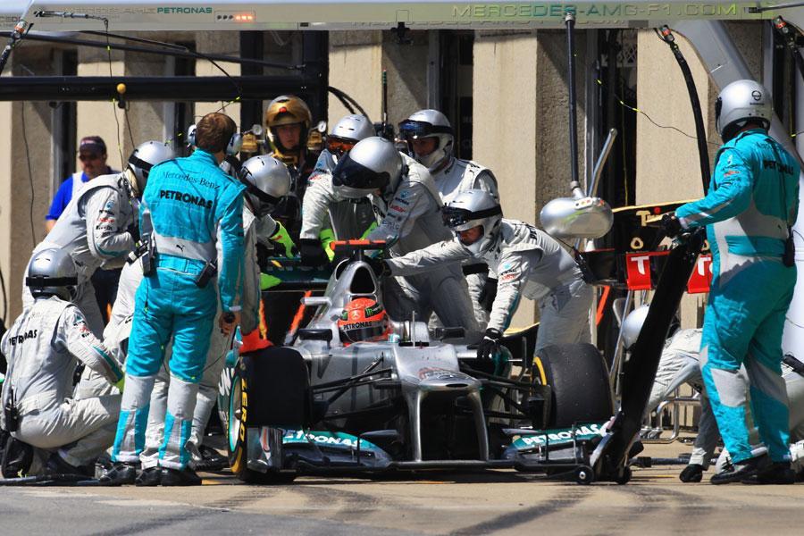 Mercedes mechanics work on Michael Schumacher's broken DRS